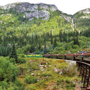 Train Turning through Coastal Mountains in Skagway, Alaska - Encircle Photos