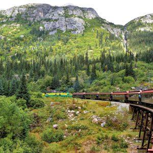 Train Turning through Coastal Mountains in Skagway, Alaska - Encircle Photos