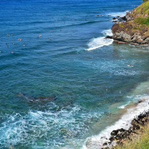 Surfers in Honolua Bay near Kapalua on Maui, Hawaii - Encircle Photos